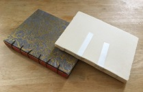 A Belgian bound book and the text block for a cross structure binding.