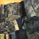 Pile of indigo-dyed shibori fabrics, made at Women's Studio Workshop, 2015