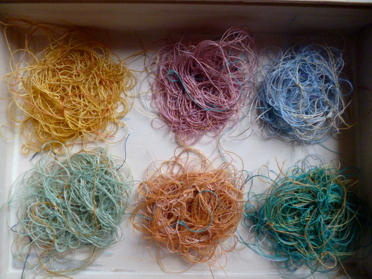 I made hundreds of these hand knotted vintage thread bunches for String Theory